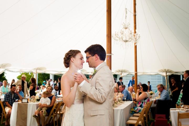 bride and groom enjoy their first dance underneath their gorgeous sailcloth tent