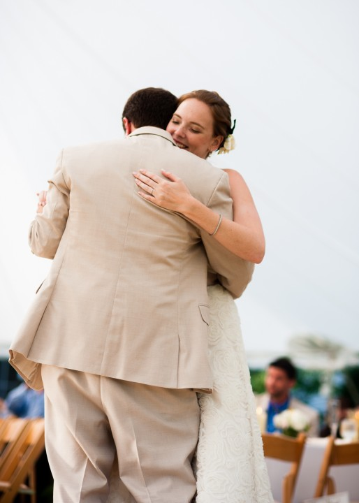 adorable couple enjoy their first dance during their beautiful tented wedding reception