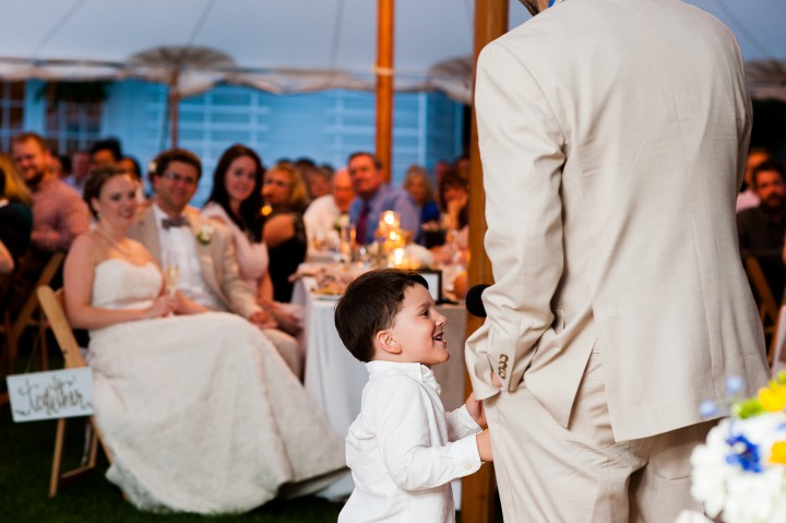 adorable ring bearer helps his dad give a toast
