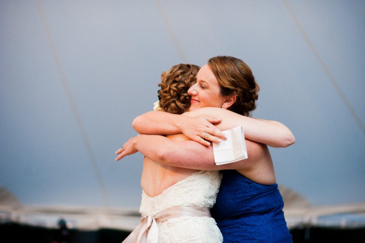 maid of honor and bride give each other a hug after maid of honors speech
