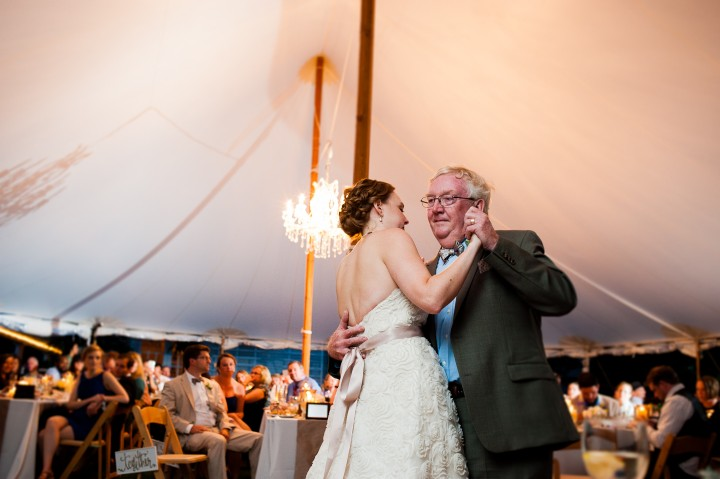 bride and her father enjoy their father daughter dance during the wedding reception