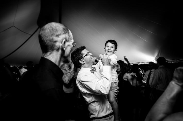 groom and little ring bearer having a blast on the dance floor