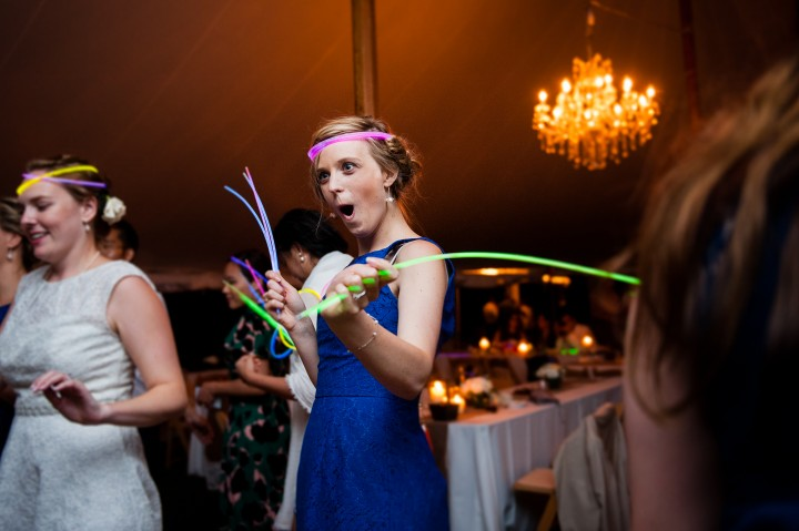 bridesmaid dances with some glow sticks on the dance floor