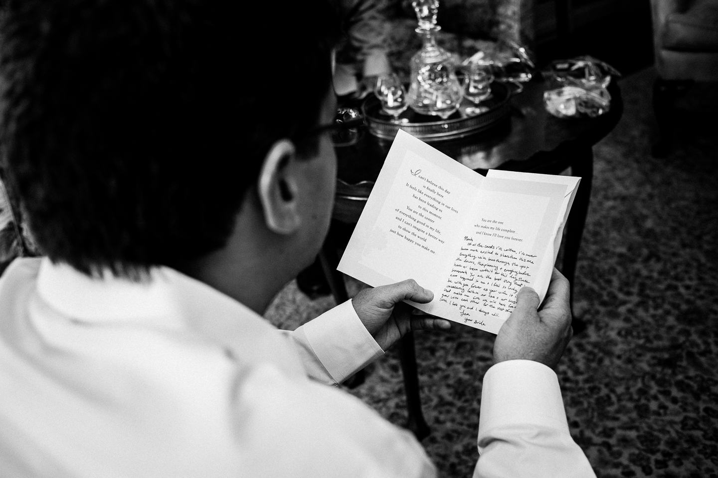 groom reads a card written by his beautiful bride to be