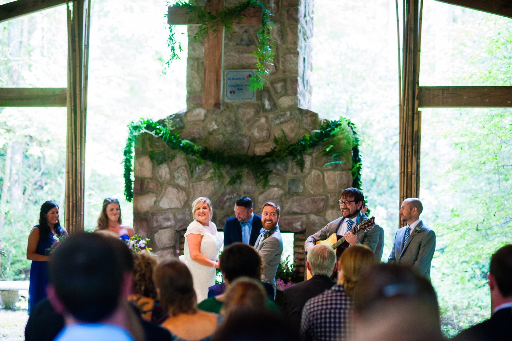 beautiful open air chapel in the woods housed this summer wedding ceremony