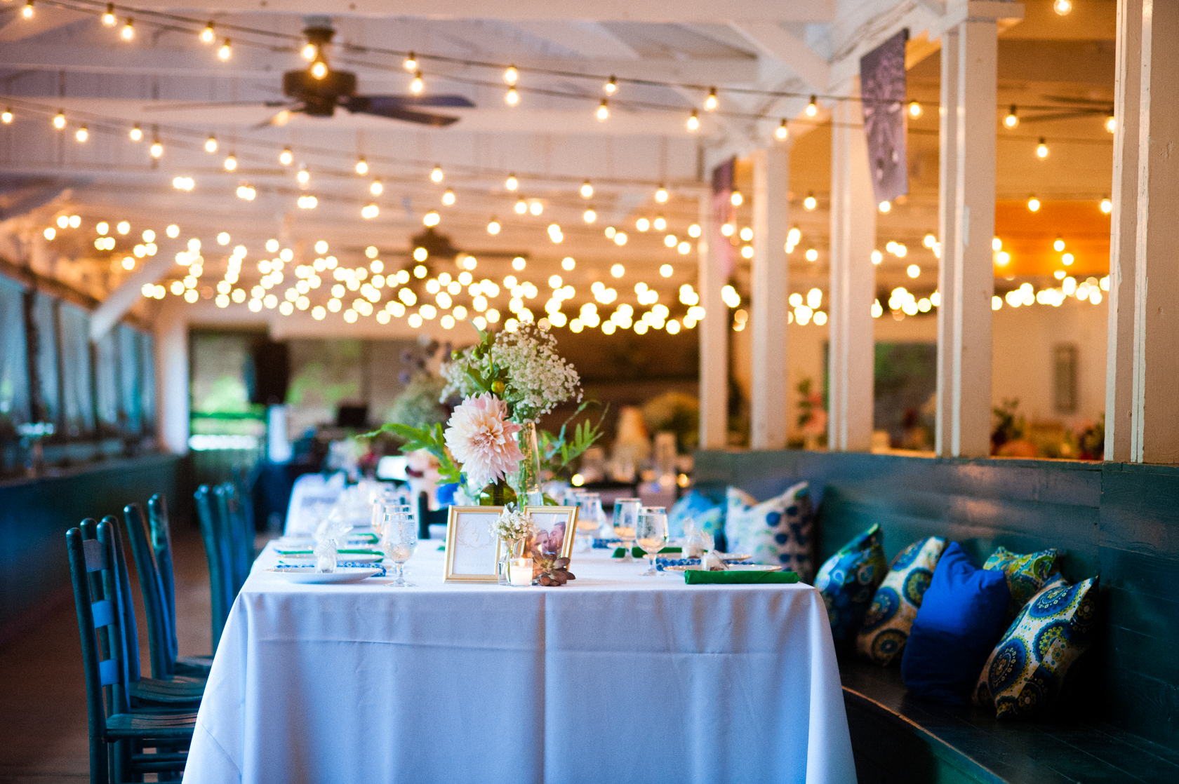 beautiful rustic summer camp reception with twinkly lights
