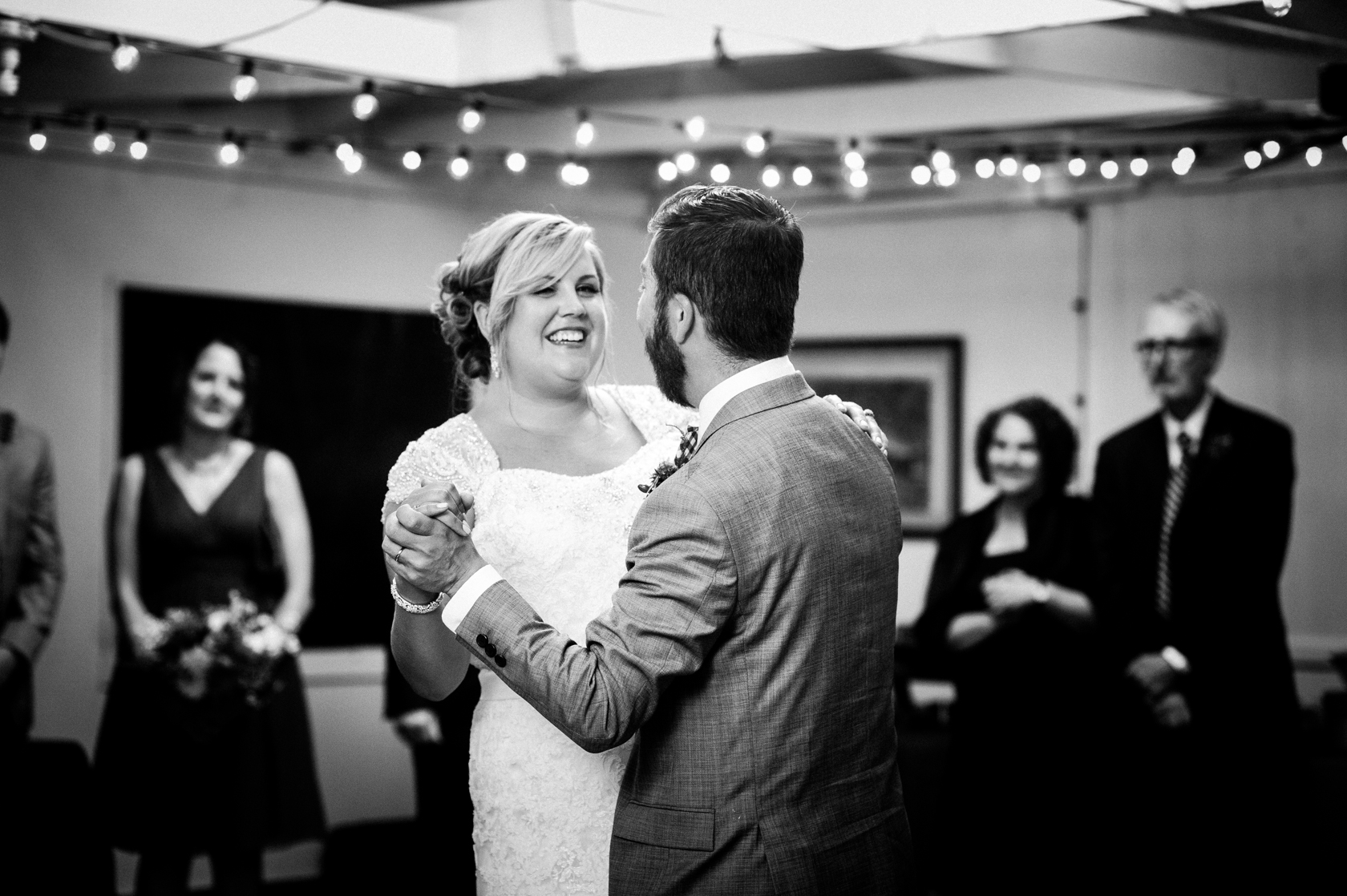 bride smiling from ear to ear during their first dance
