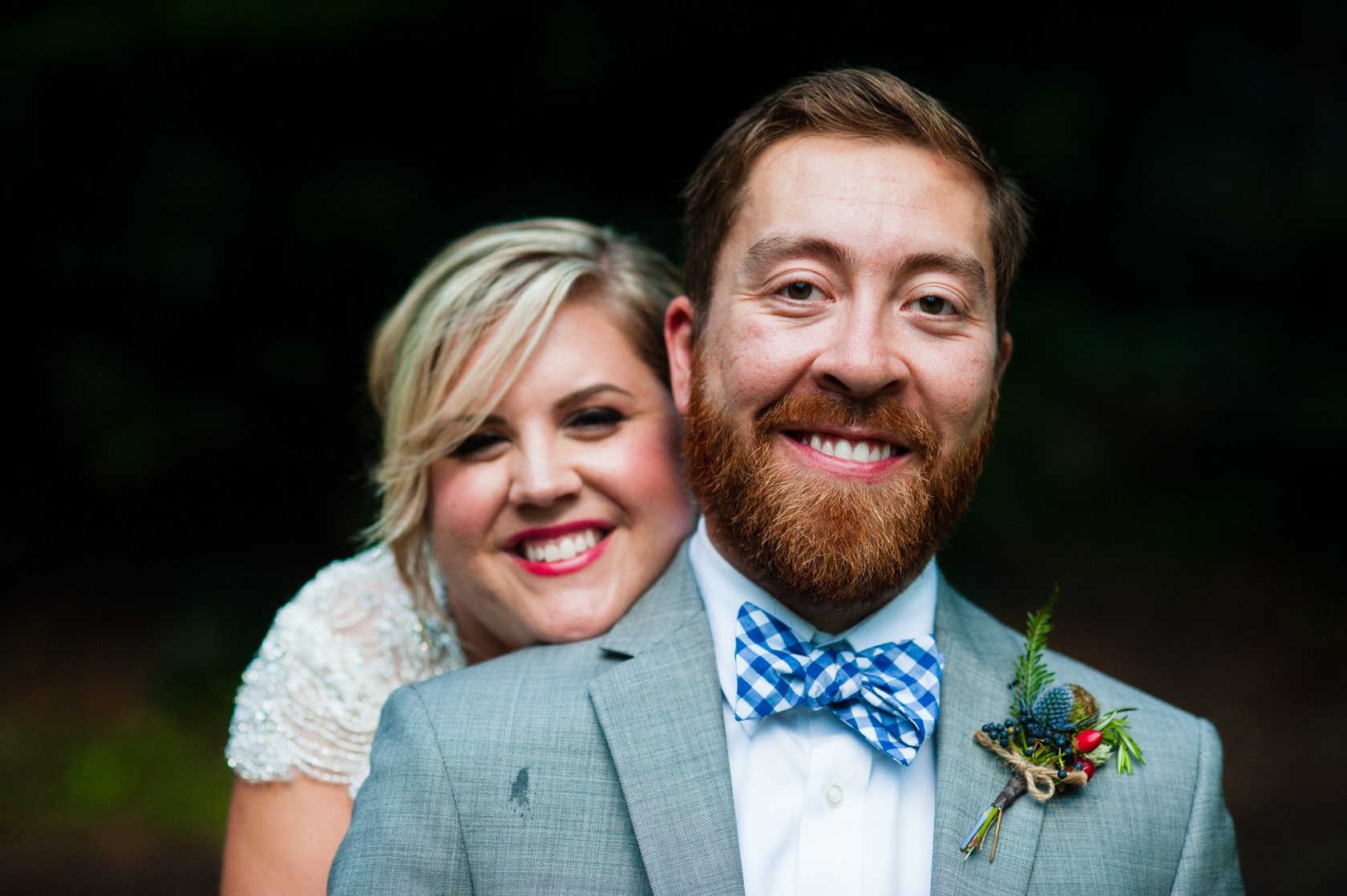 bride and groom smiling at the camera during their summer camp wedding portraits