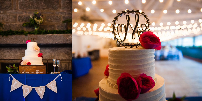 beautiful lights hung behind an elegant white wedding cake