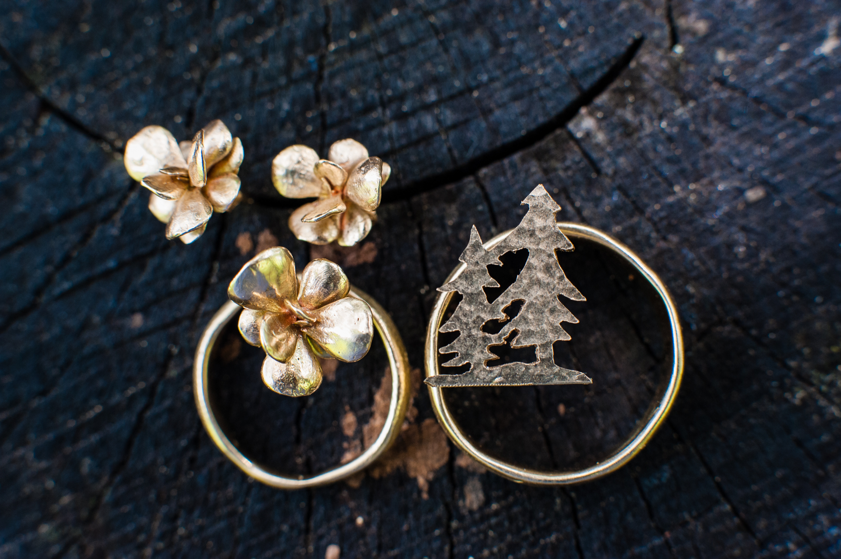 Gorgeous gold earings with matching wedding bands made by a very creative bride
