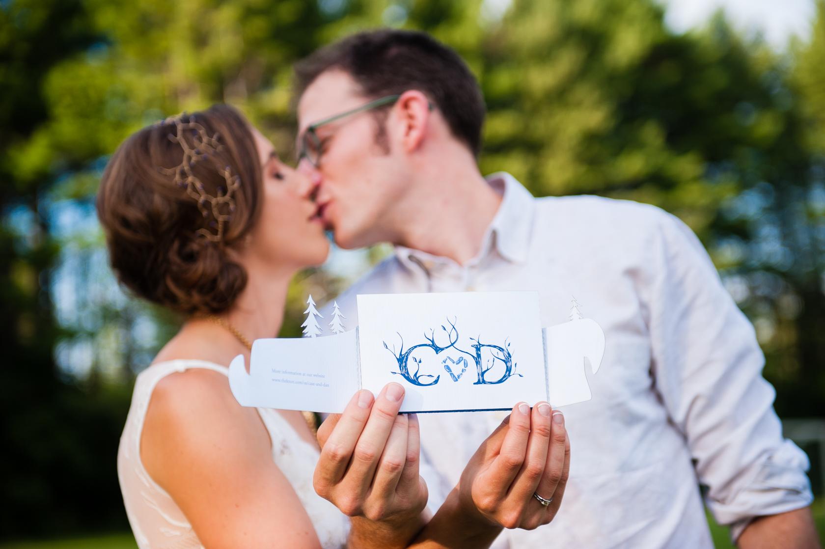 beautiful bride and groom show off their beautiful handmade stationary