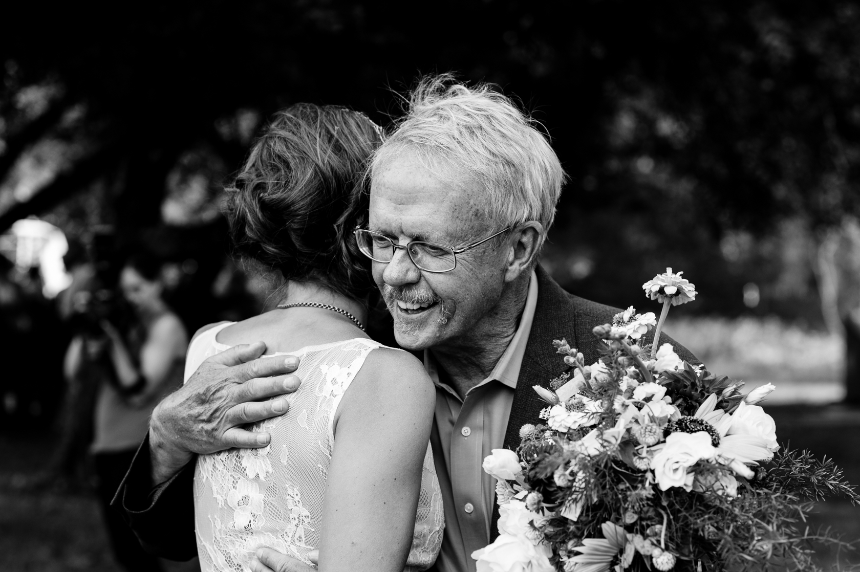 bride and her dad give each other a quick hug before he walks her down the aisle
