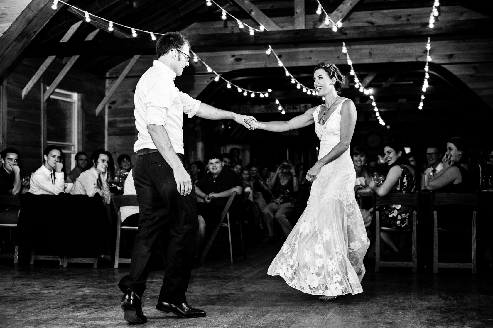 bride and groom laughing during their dynamic first dance