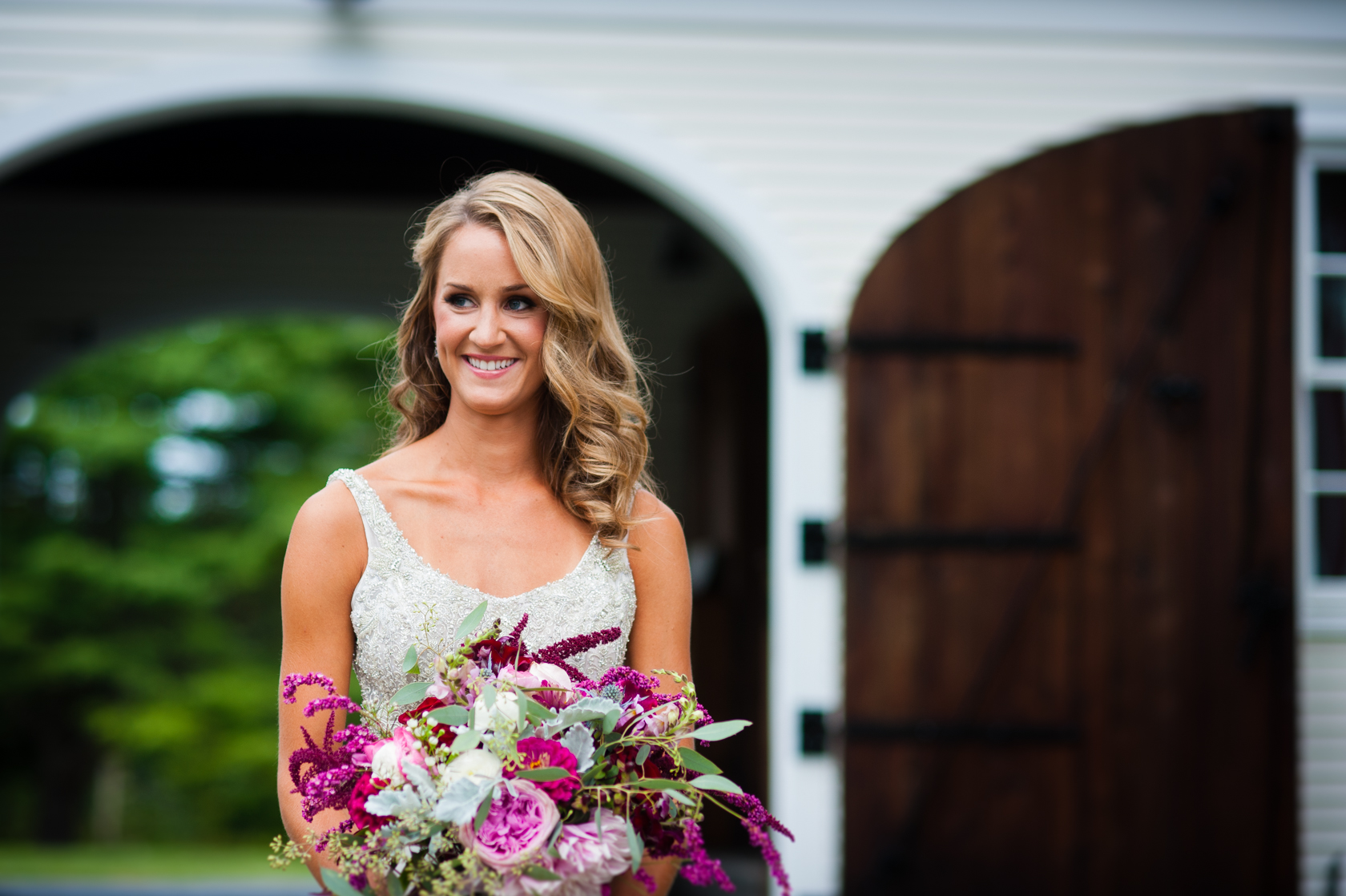 gorgeous bride holds her large floral bouquet