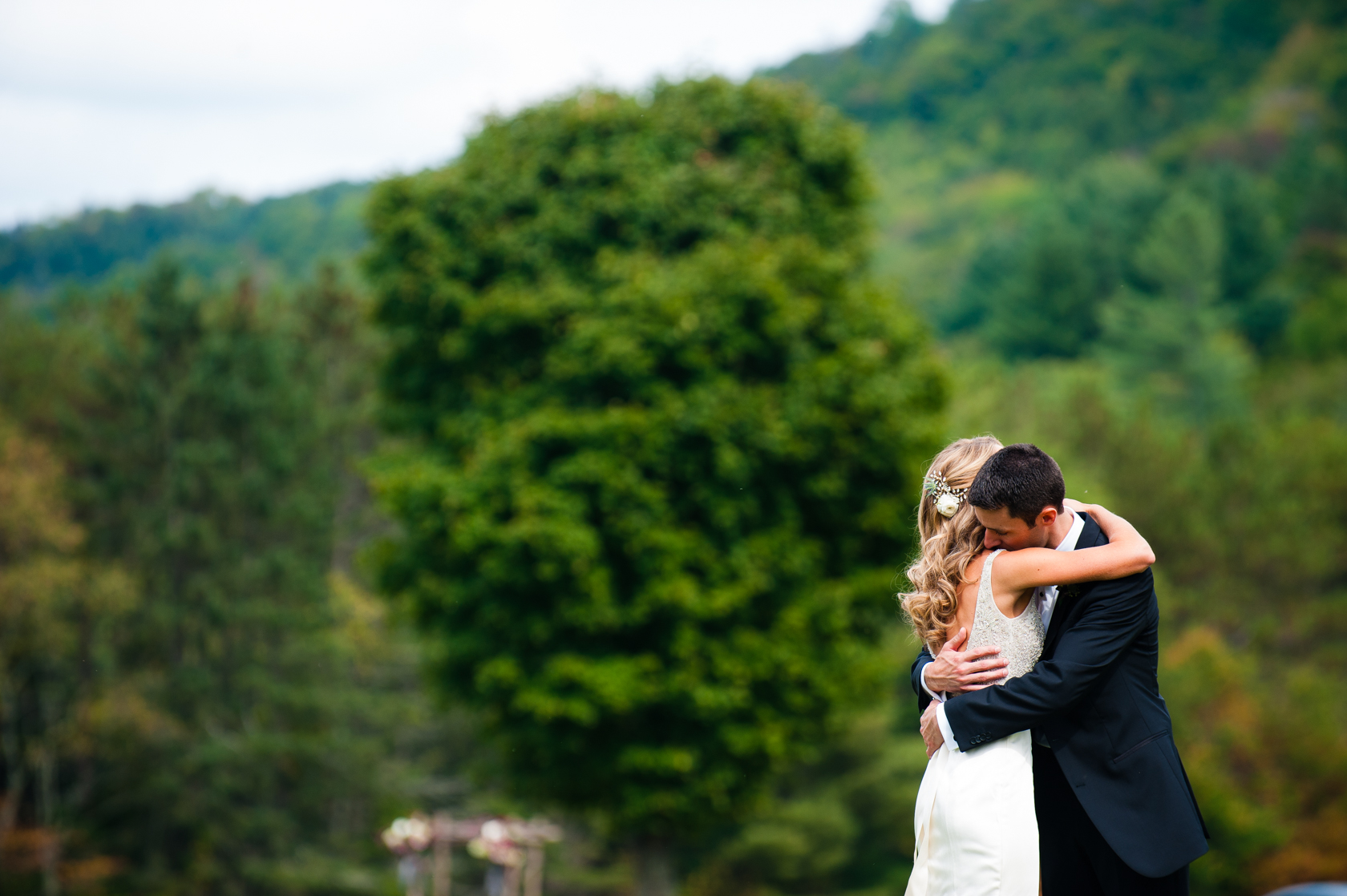 bride and groom hugging after seeing each other for the first time