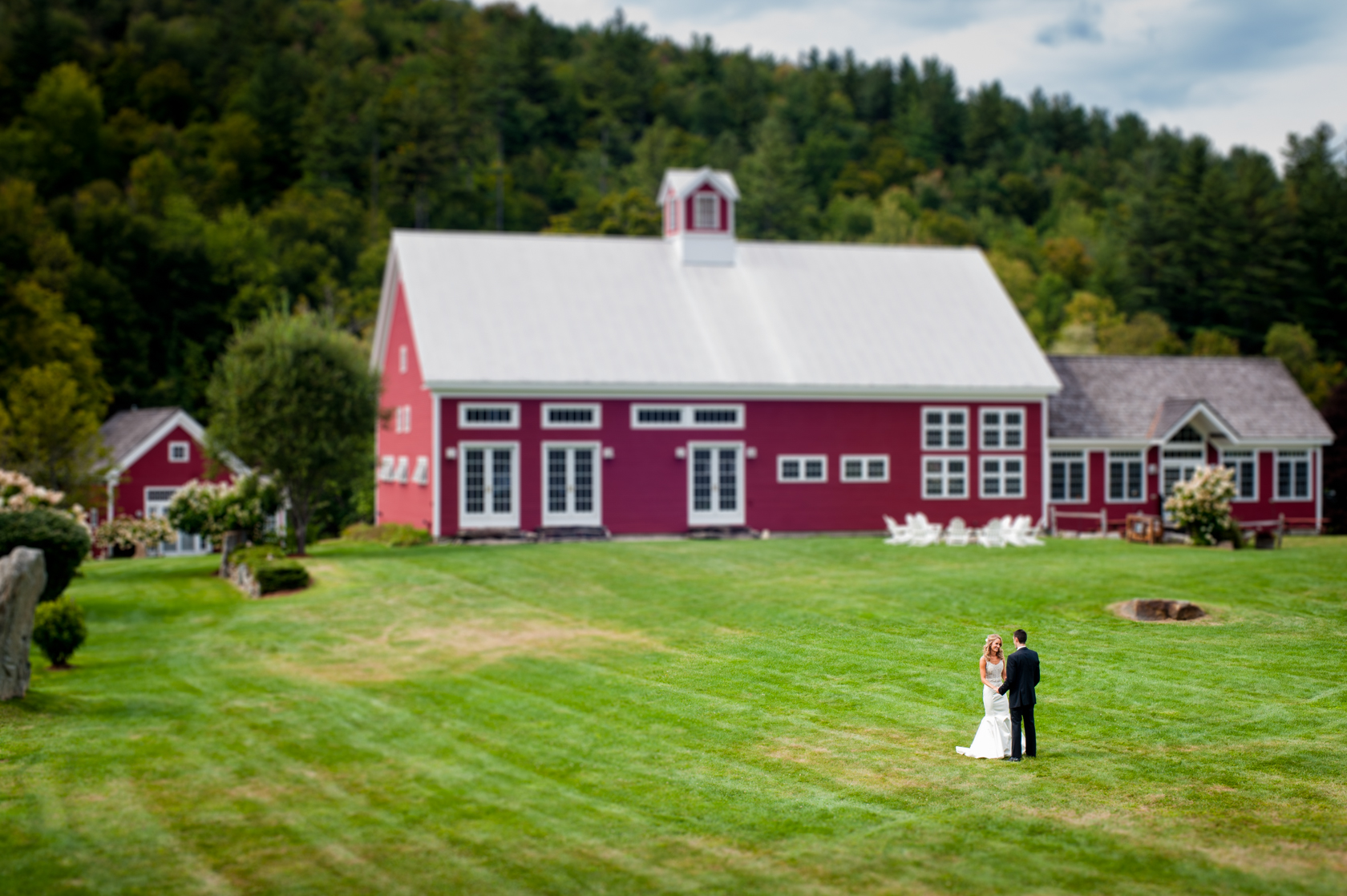 beautiful bride and groom first look in front of a gorgeous red barn