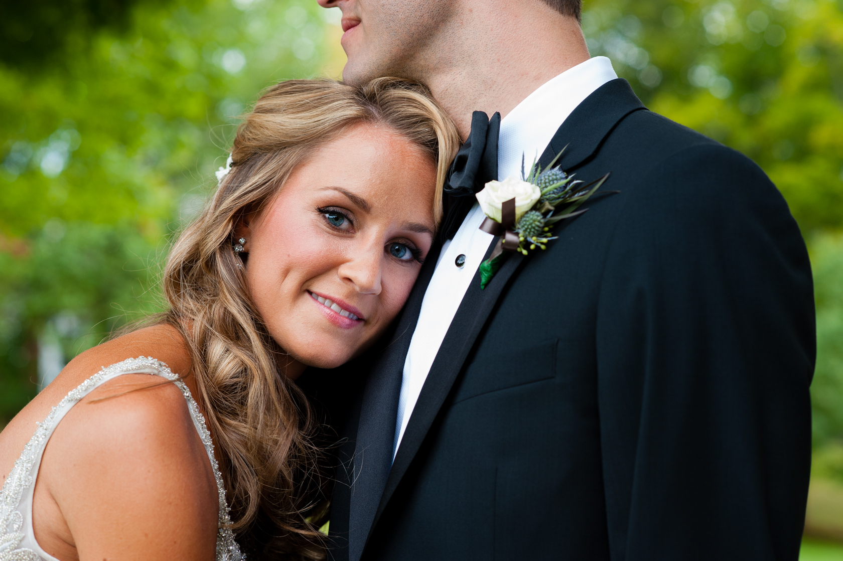 beautiful bride rests her head on her new husbands chest