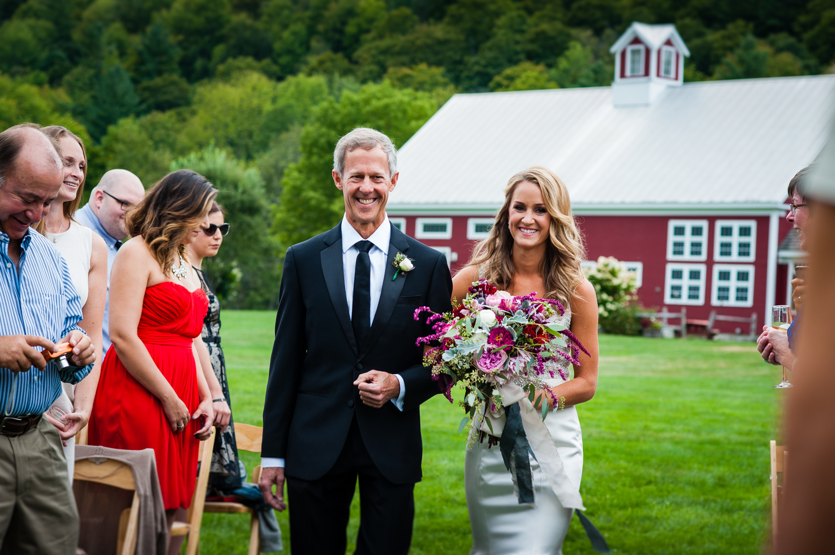 beaming dad walks his beautiful daughter down the aisle to get married