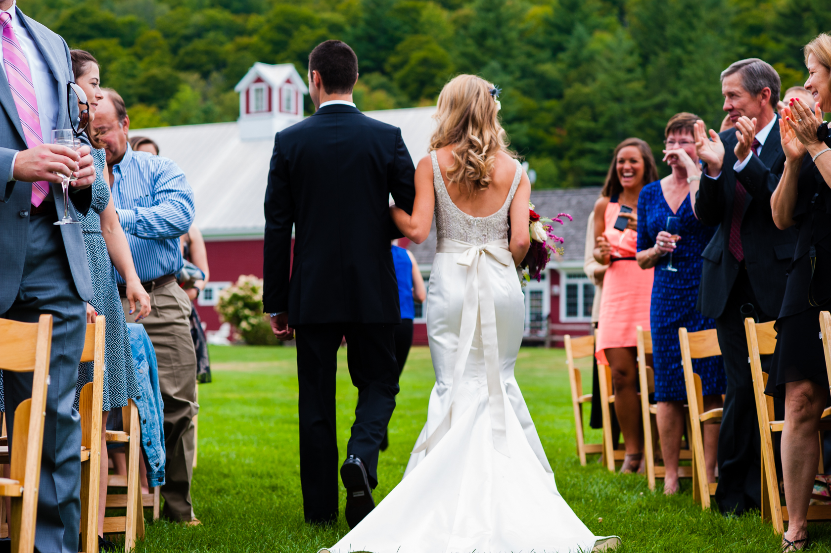bride and groom walk down the aisle after their wedding ceremony