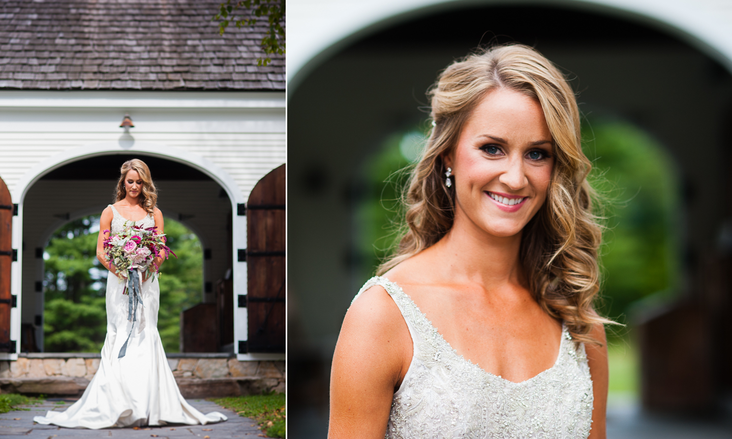gorgeous bride in front of white barn