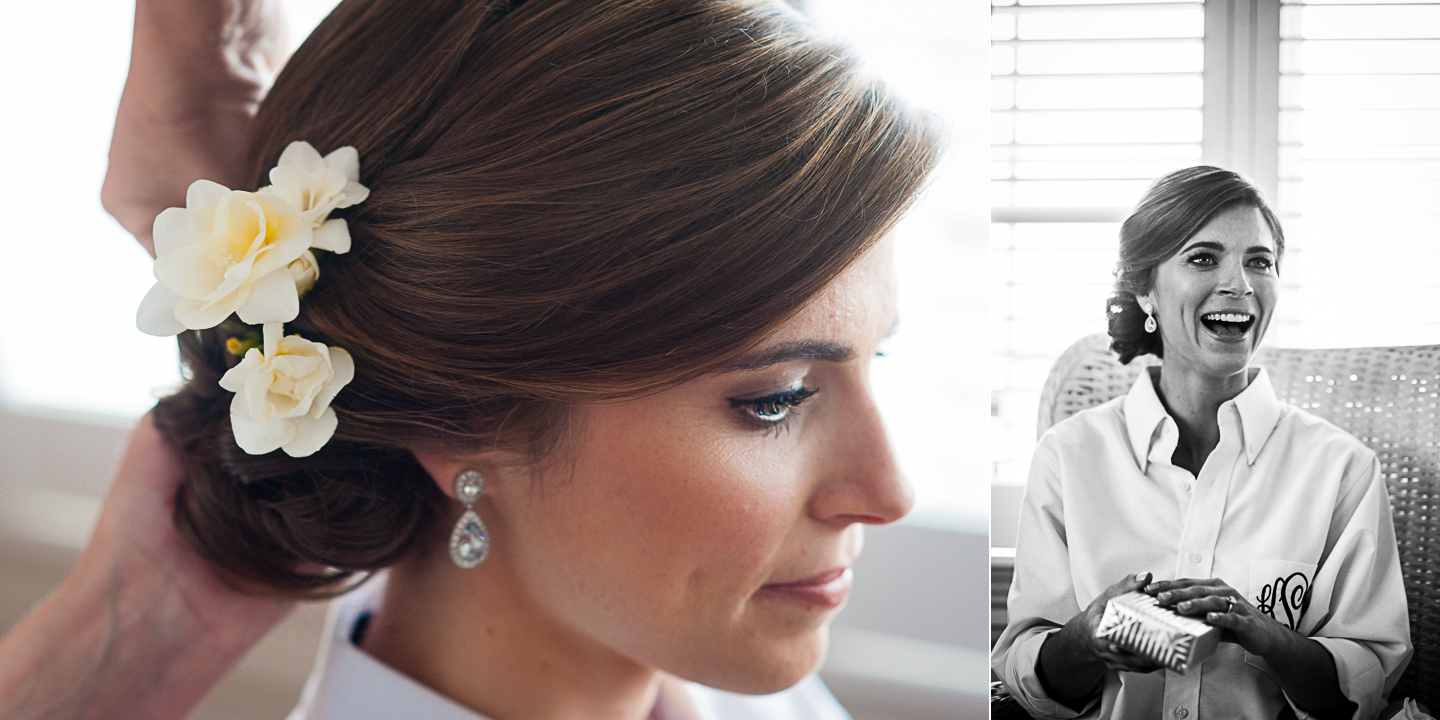 bride shows off the simple white flower in her hair