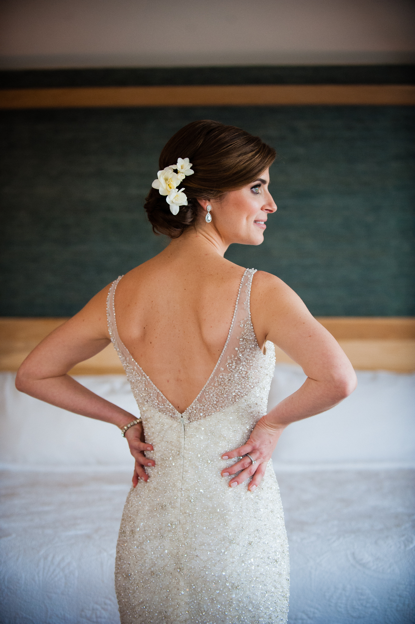 beautiful bride shows off her low cut back beaded wedding gown
