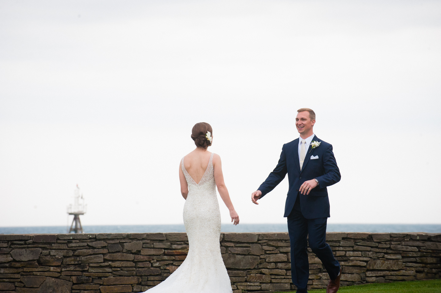 bride and groom very excited to see each other during their oceanside first look