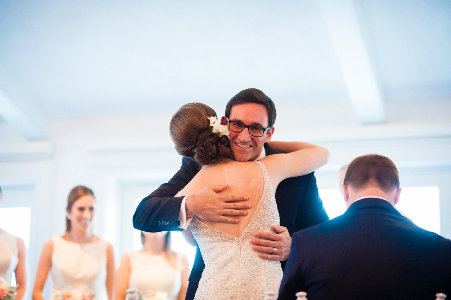 bride and a ceremony reader give each other a hug