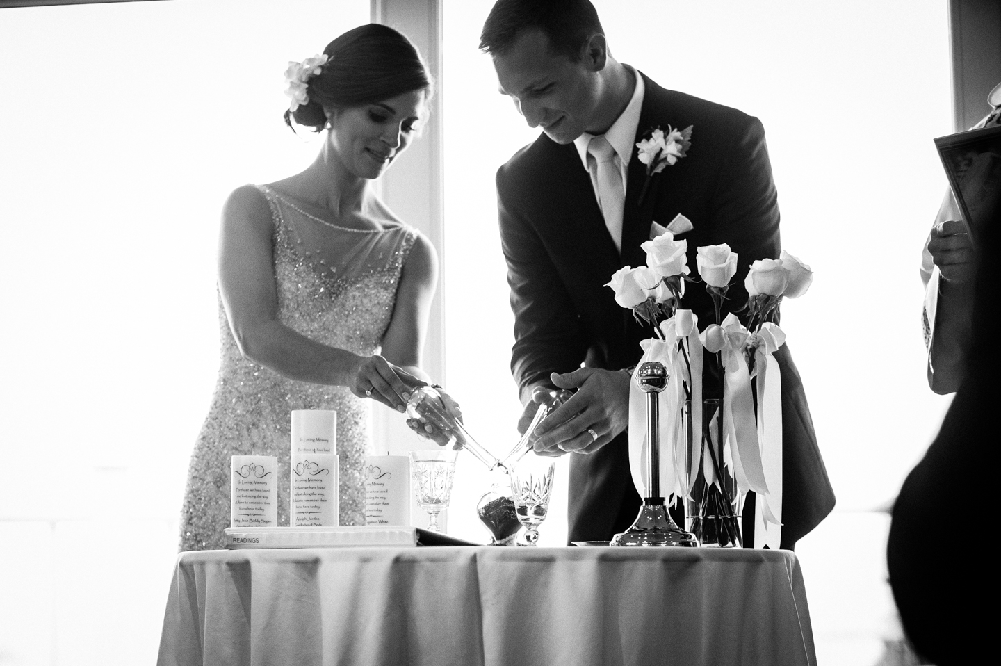 bride and groom light a unity candle