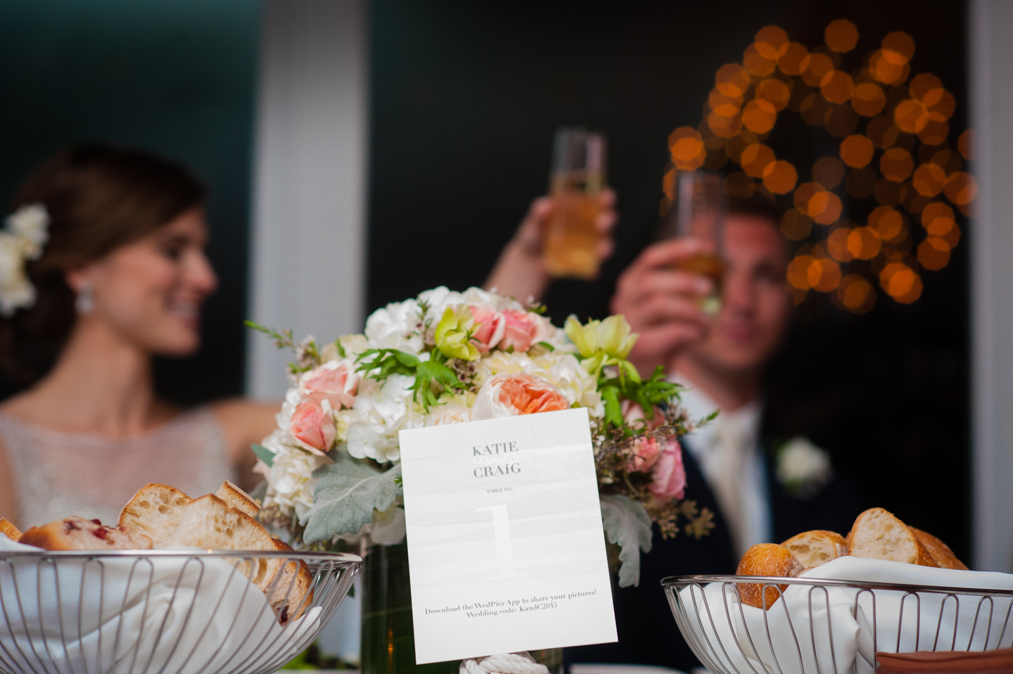 bride and groom toast in the background of this photo