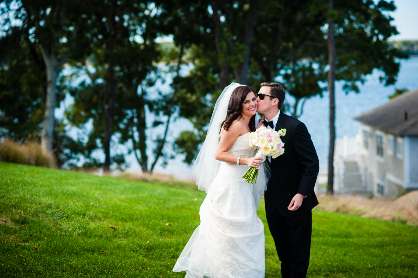 groom gives his gorgeous bride a kiss