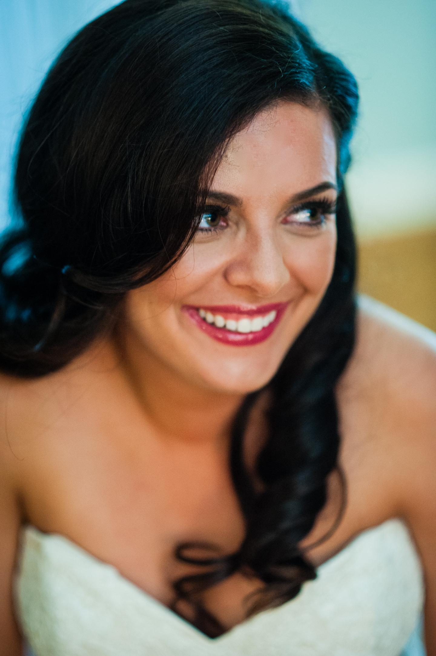 beautiful bride smiling at her bridesmaids
