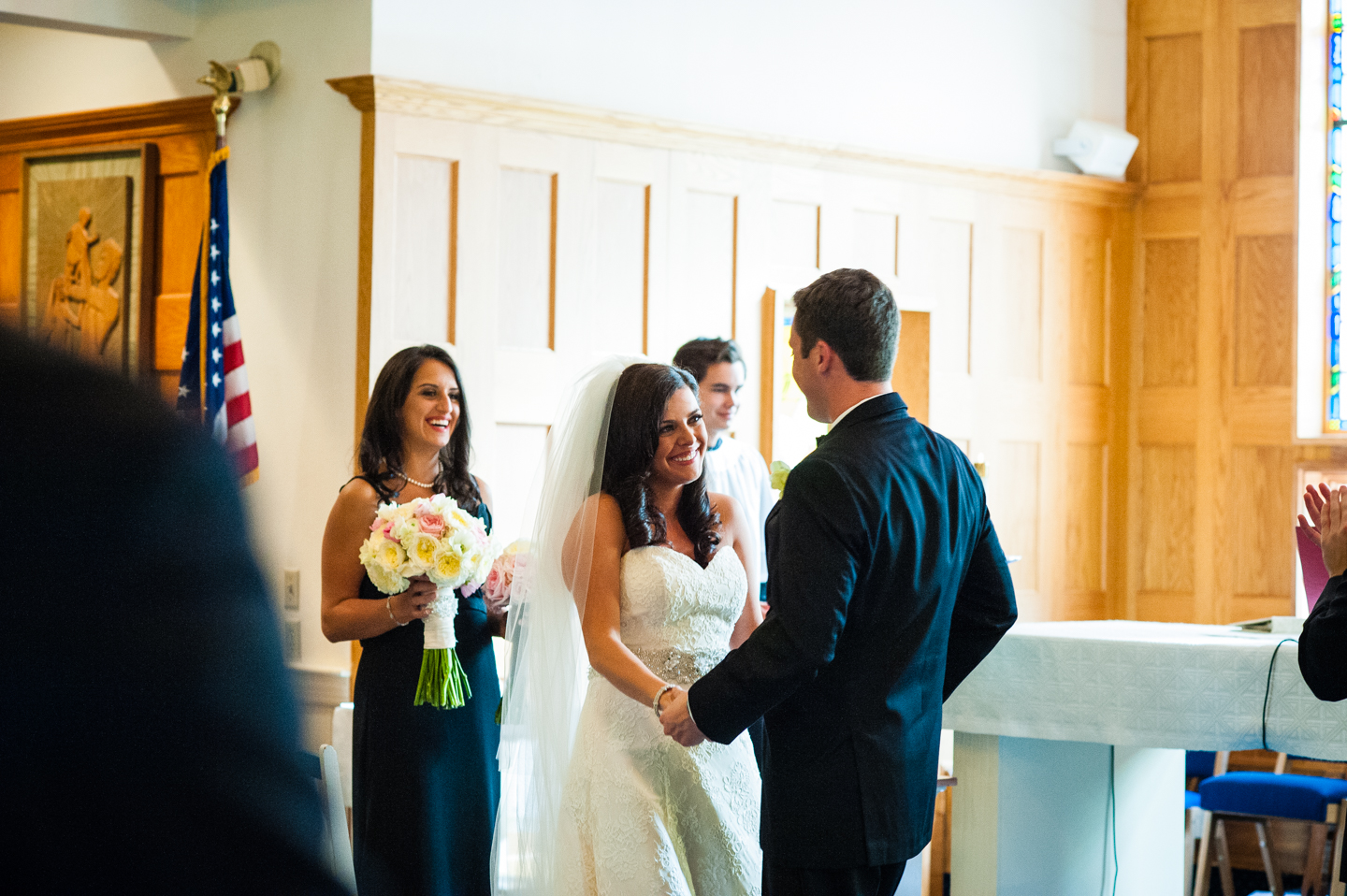 bride smiling at her husband during their ceremony