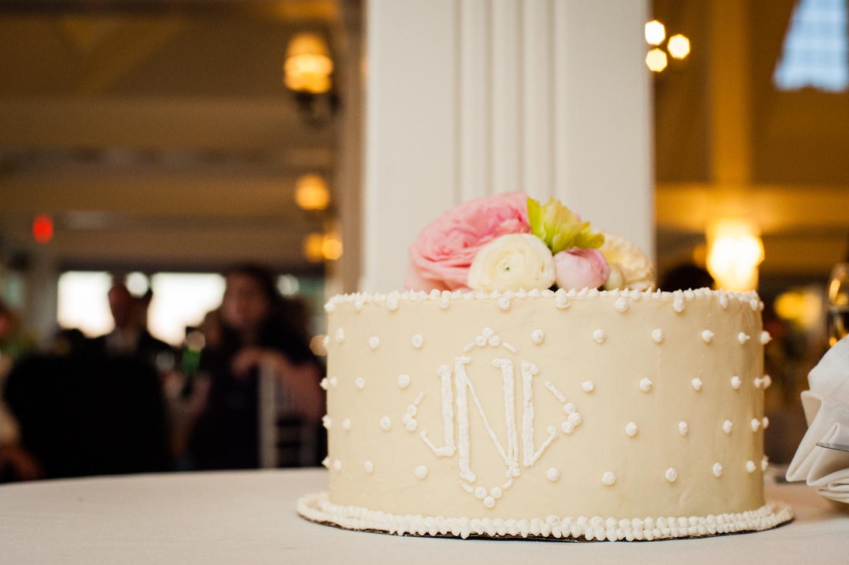 gorgeous classic wedding cake with fresh flowers