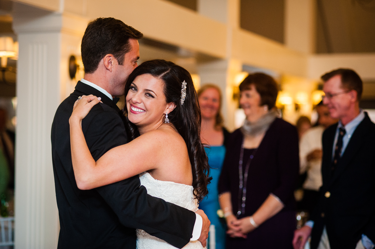 bride beaming during her first dance