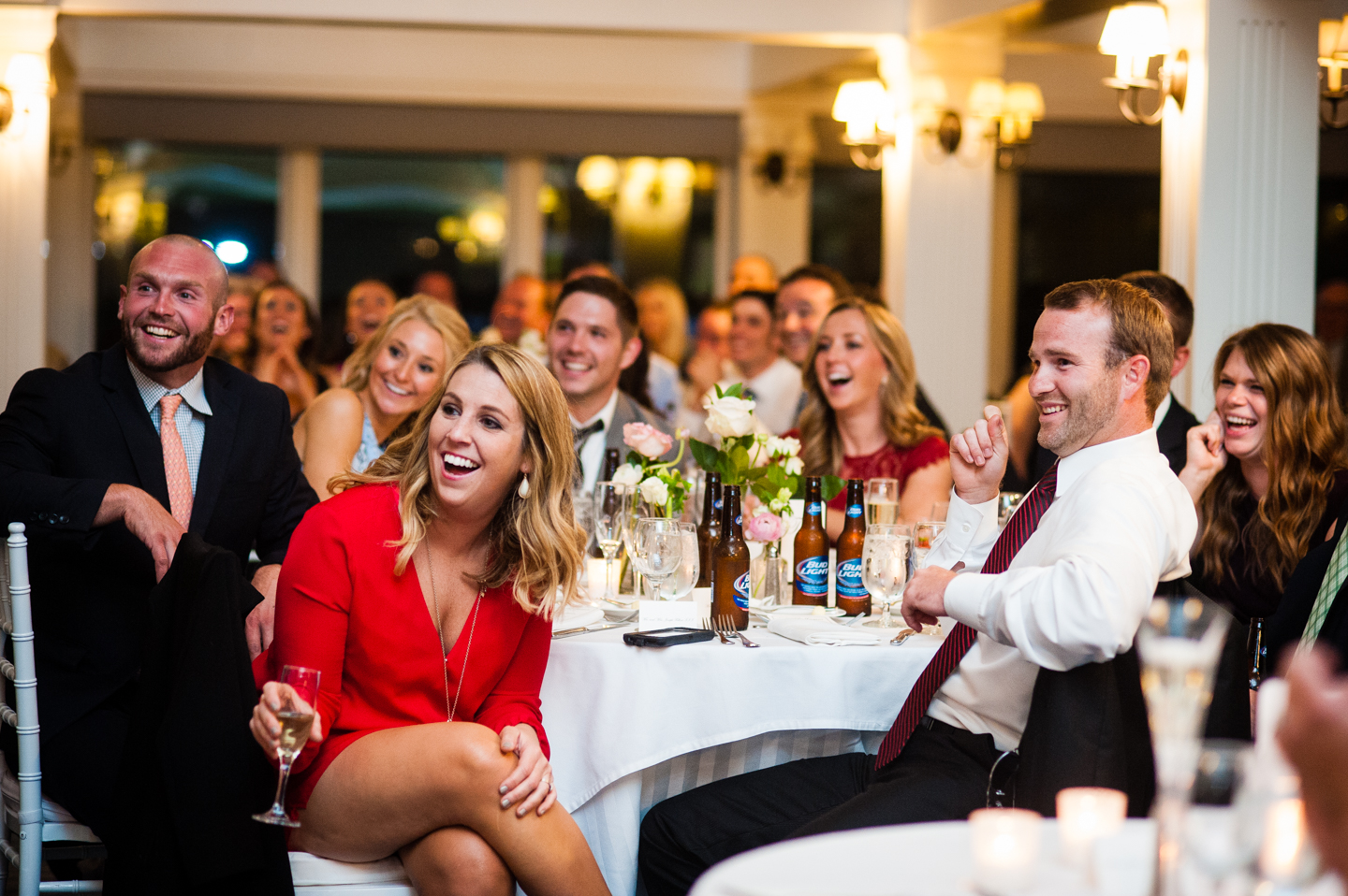 wedding guests laugh during a fantastic wedding toast