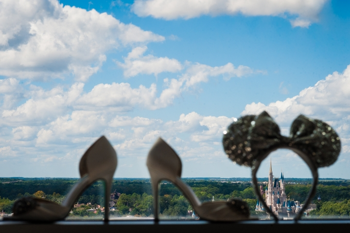 disneys magical kingdom framed by brides shoes in a window
