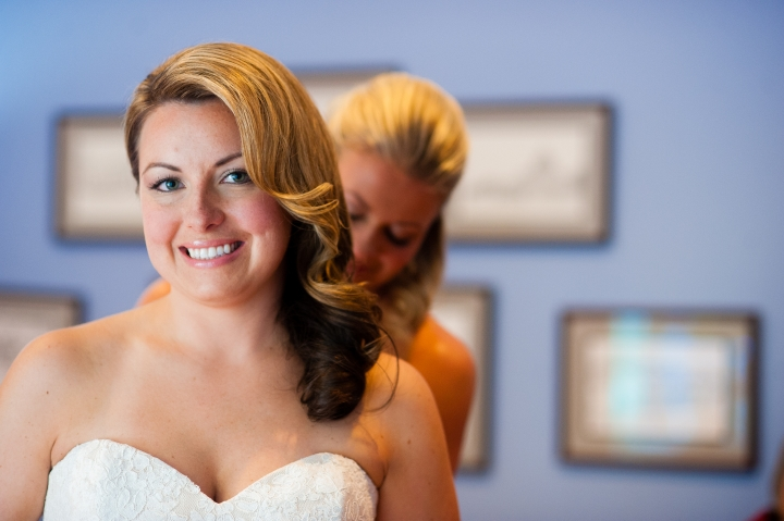 brides gets into classic lace wedding dress