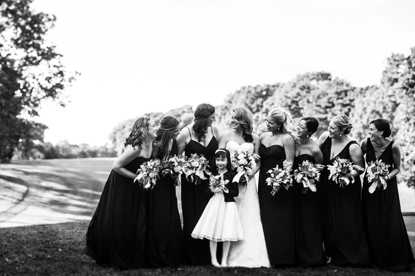 bride and gorgeous bridesmaids laughing during portraits