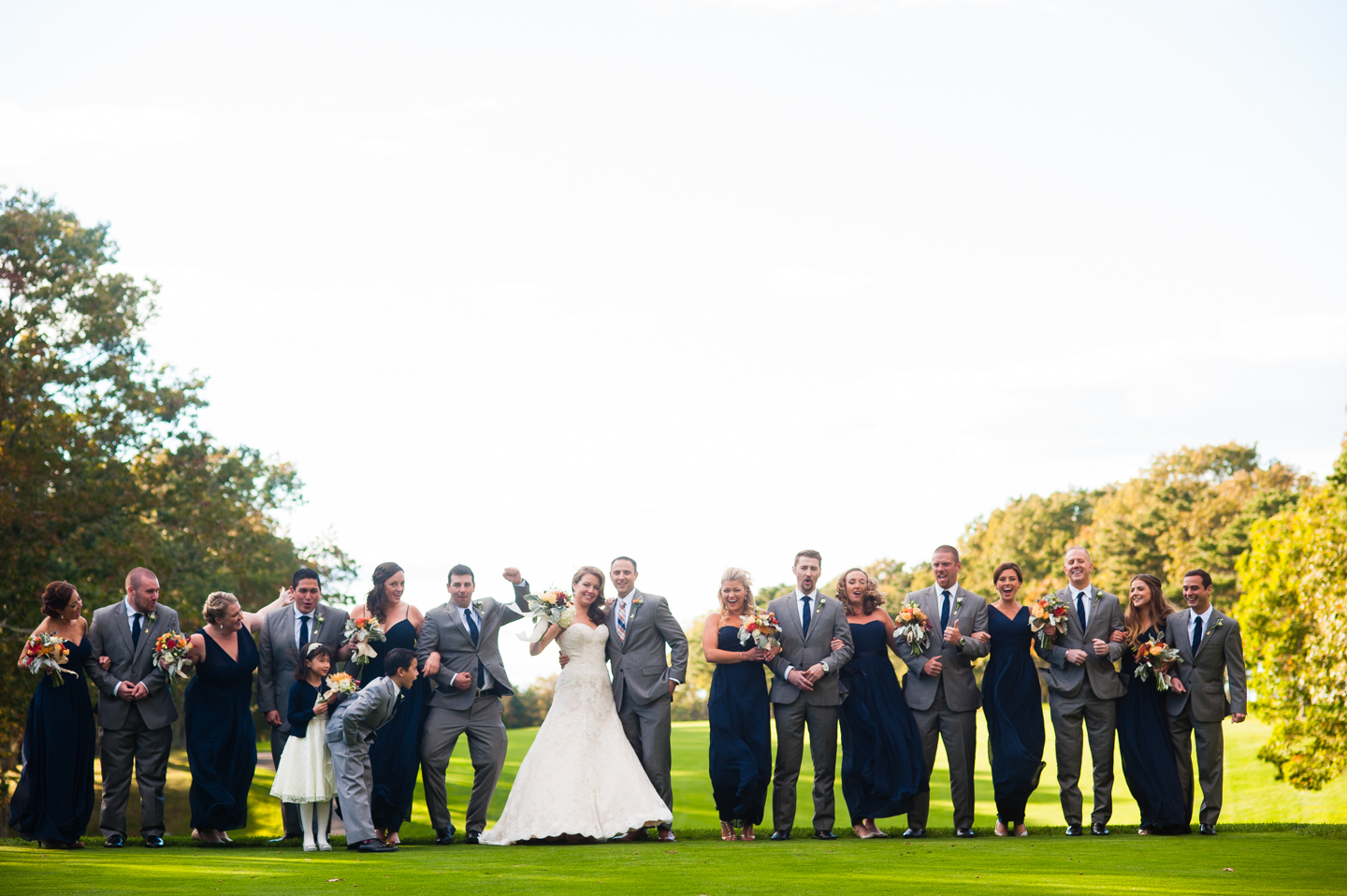 excited wedding party cheers on golf course
