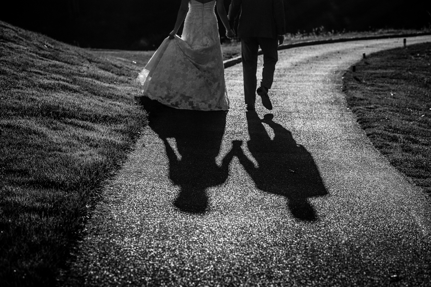 dramatic black and white image of bride and groom