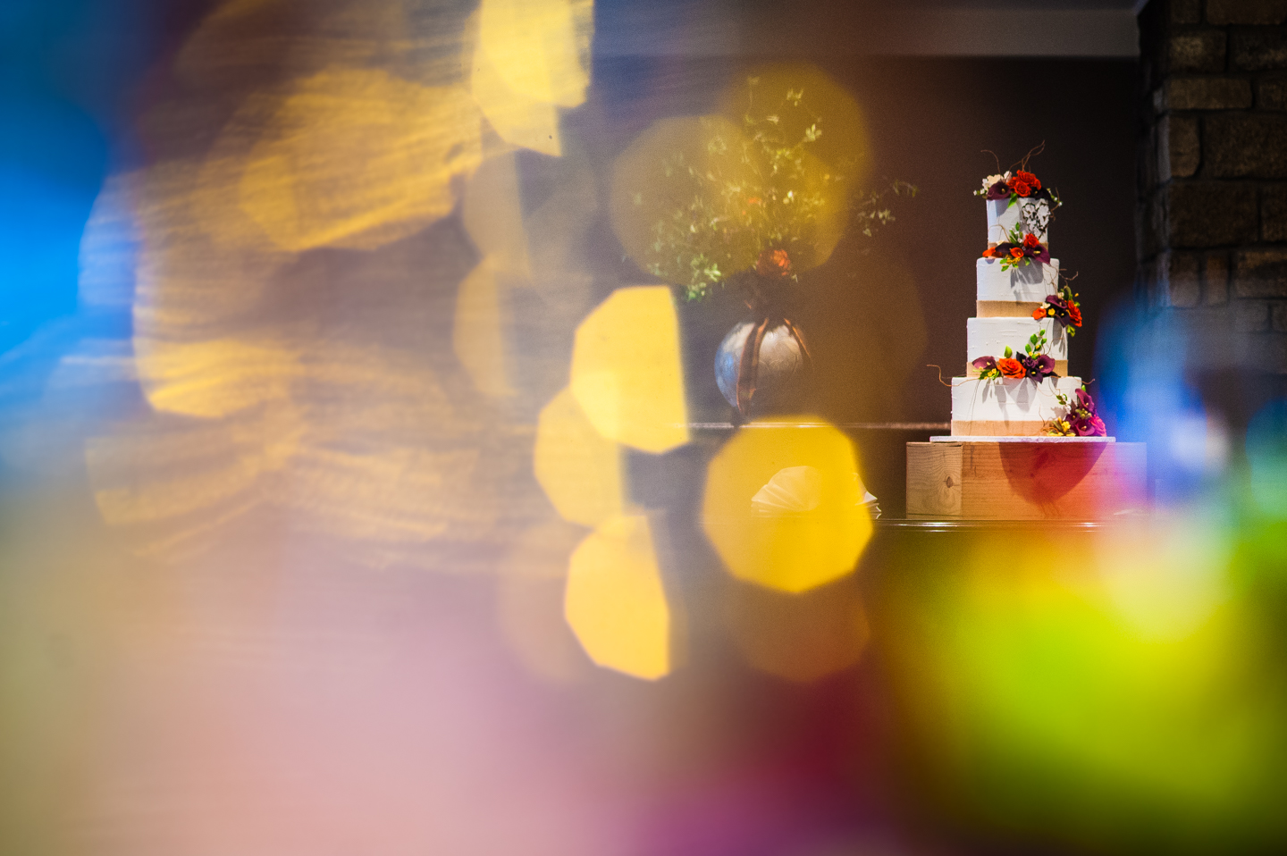 gorgeous tiered wedding cake with birch bark and flowers