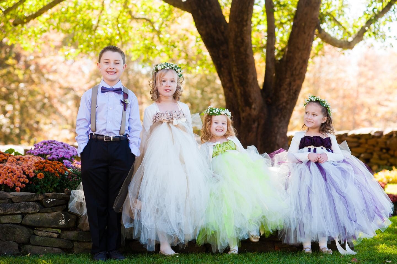 gorgeous fairytale flower girls pose in garden wedding