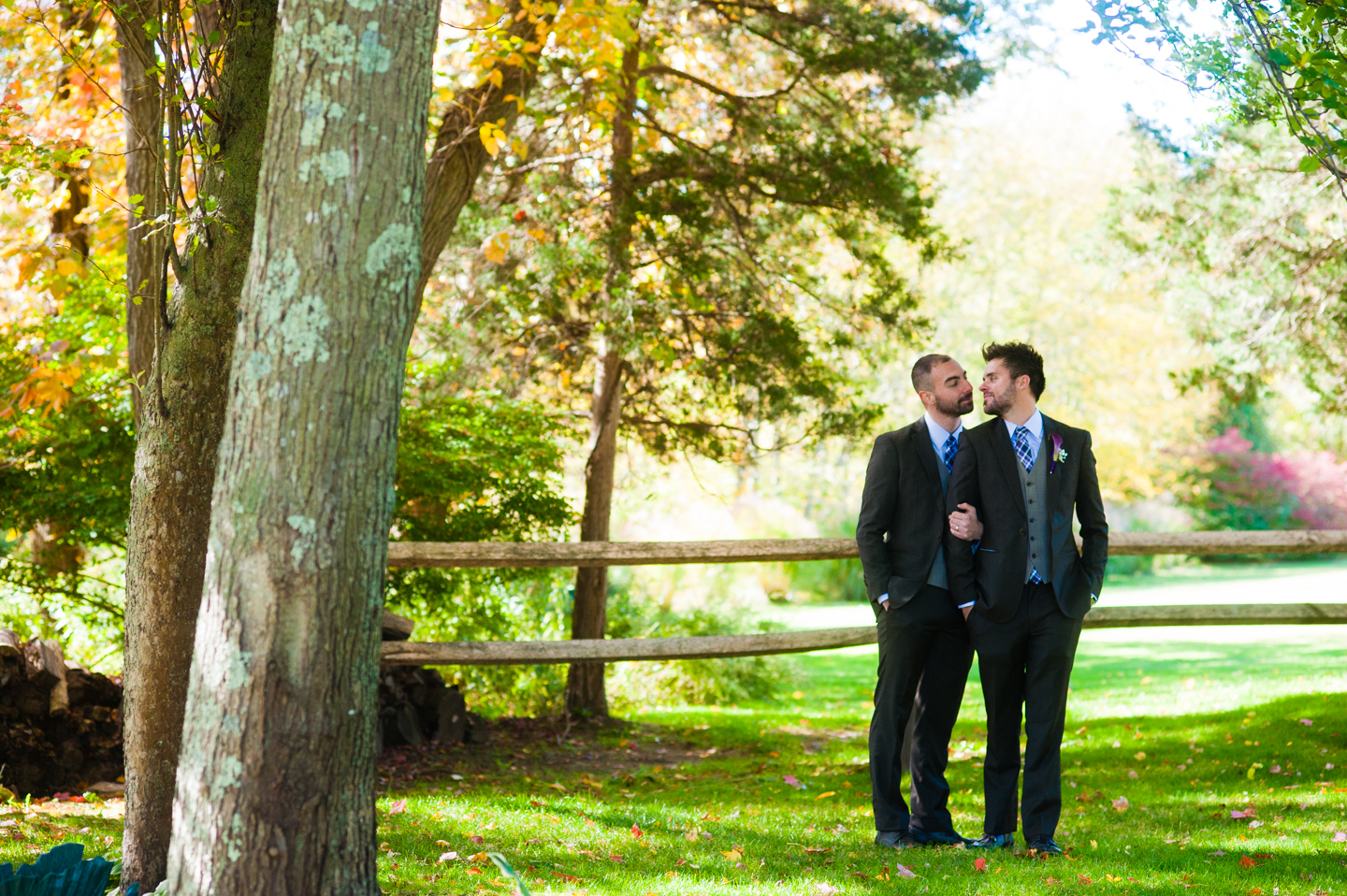 two handsome grooms same sex fall wedding