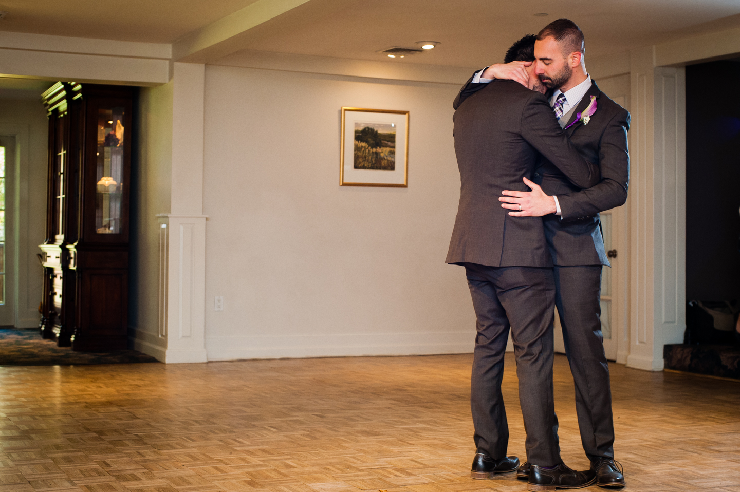 first dance between two grooms during fall wedding
