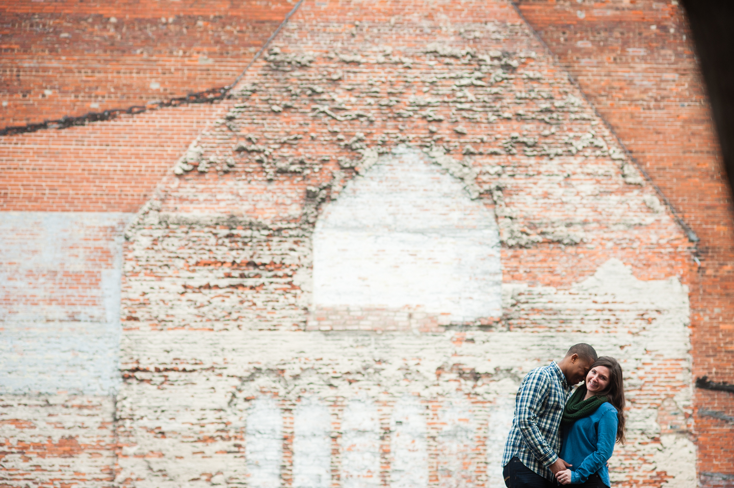 fiance gives his bride to be a kiss on the cheek