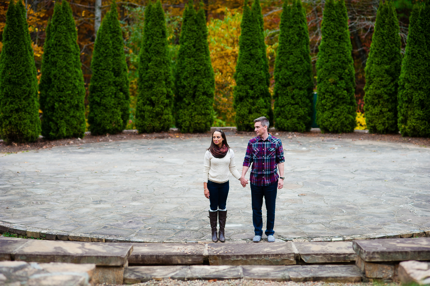 couple holds hands during asheville arboretum engagement session