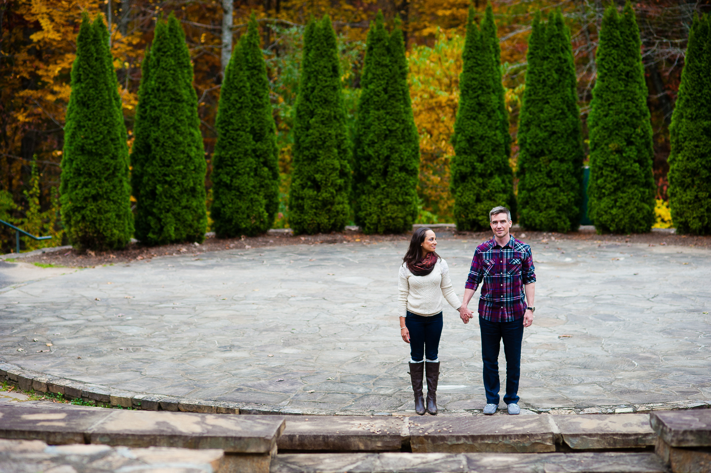 stylish couple at nc arboretum amphitheater steps