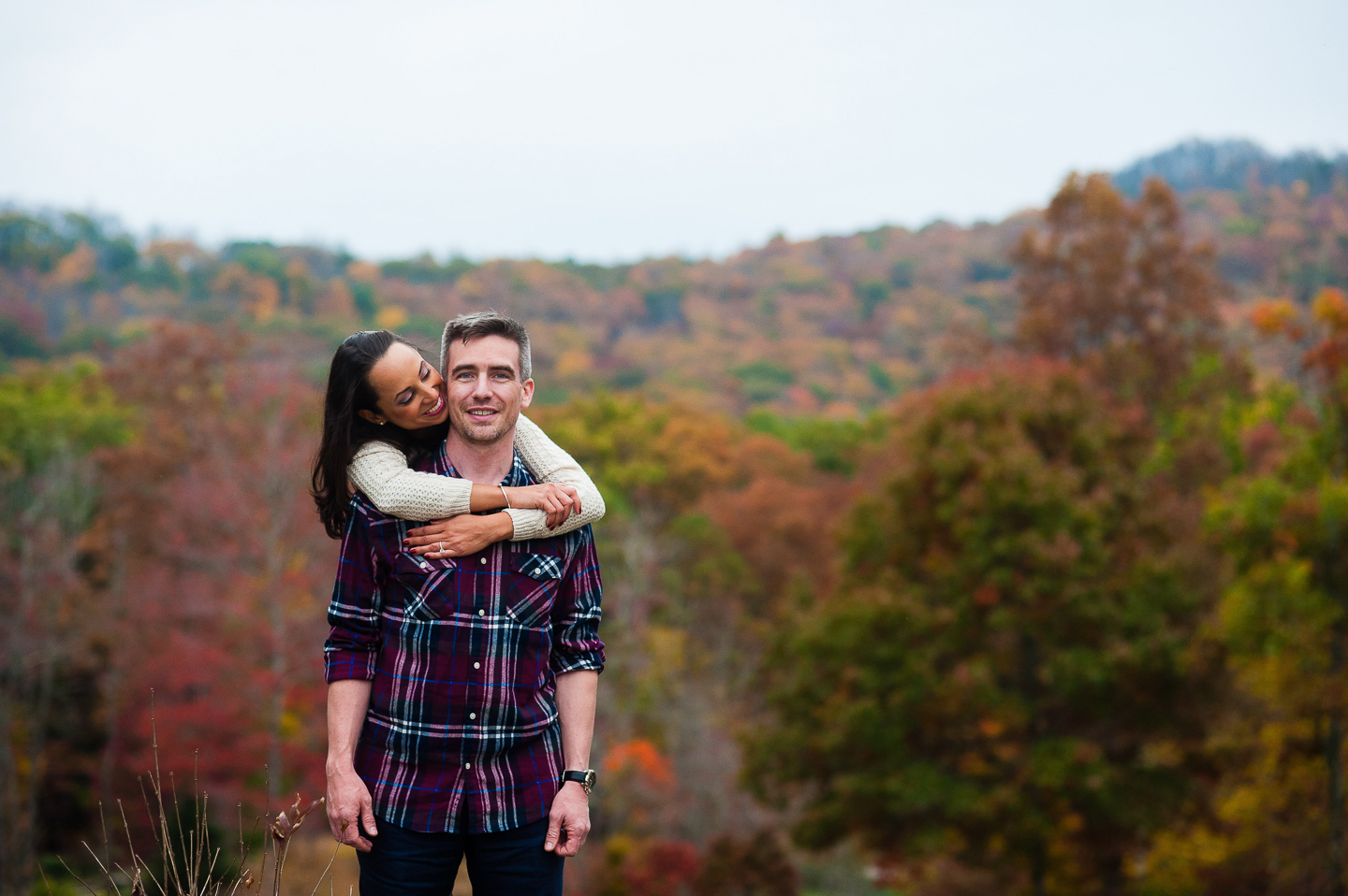 young couple fall foliage at nc arboretum
