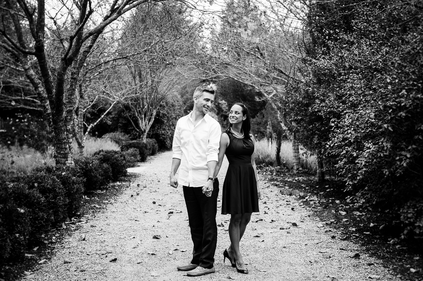 NC Arboretum pathway with engaged couple holding hands